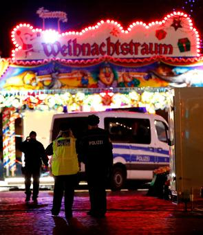 Police at the Christmas market in the German city of Potsdam, near Berlin, yesterday. Photo: Reuters/Fabrizio Bensch