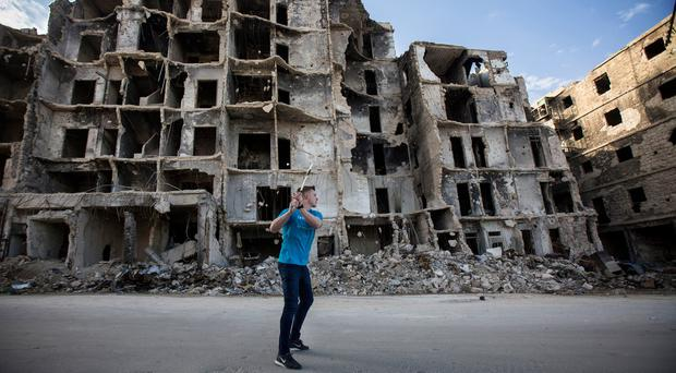 Hurling star and Unicef Ireland goodwill ambassador Joe Canning in the largely-destroyed Maysaloun area of east Aleppo. Pic:Mark Condren