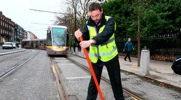 LUAS Driver Team Leader and Incident Manager, Philip Eyre pictured changing the points manually at on the LUAS Cross City Line at the top of Dawson Street/ St Stephens Green. Photo: Frank Mc Grath