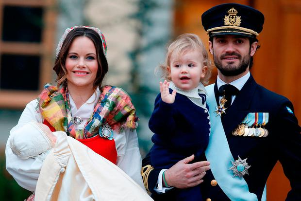 Prince Gabriel of Sweden, Duke of Dalarna held by Princess Sofia of Sweden and Prince Carl Philip holding Prince Alexander, Duke of Sodermanland is the second child of and attends the christening of Prince Gabriel of Sweden at Drottningholm Palace Chapel on December 1, 2017 in Stockholm, Sweden. (Photo by Michael Campanella/Michael Campanella/Getty Images)
