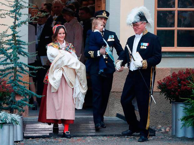 Prince Gabriel of Sweden, Duke of Dalarna held by Princess Sofia of Sweden and Prince Carl Philip holding Prince Alexander, Duke of Sodermanland leave the chapel after the christening of Prince Gabriel of Sweden at Drottningholm Palace Chapel on December 1, 2017 in Stockholm, Sweden. (Photo by Michael Campanella/Michael Campanella/Getty Images)