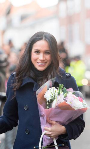 Meghan Markle meets well-wishers as she arrives with Prince Harry at the Nottingham Contemporary in Nottingham, to attend a Terrence Higgins Trust World AIDS Day charity fair on their first official engagement together