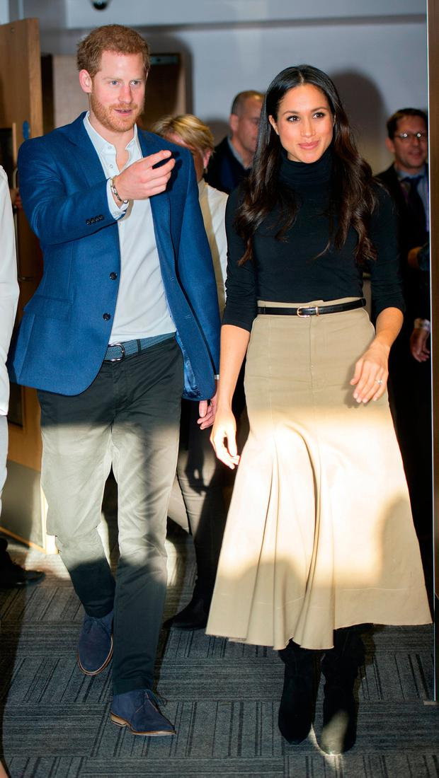 Prince Harry and his fiancee US actress Meghan Markle visit Nottingham Academy on December 1, 2017 in Nottingham, England