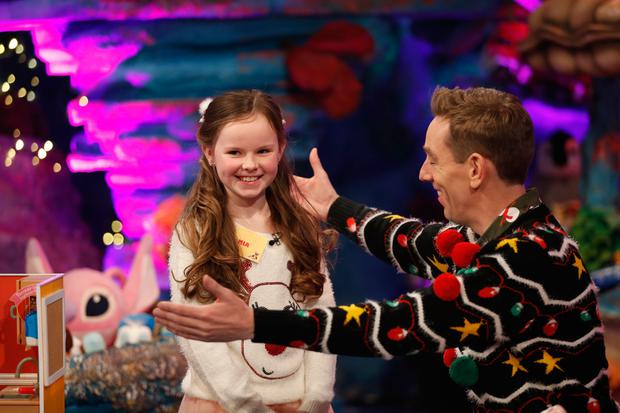 Mia Farrell from Bluebell in Dublin demonstrating toys with presenter Ryan Tubridy. Picture Andres Poveda / RTE