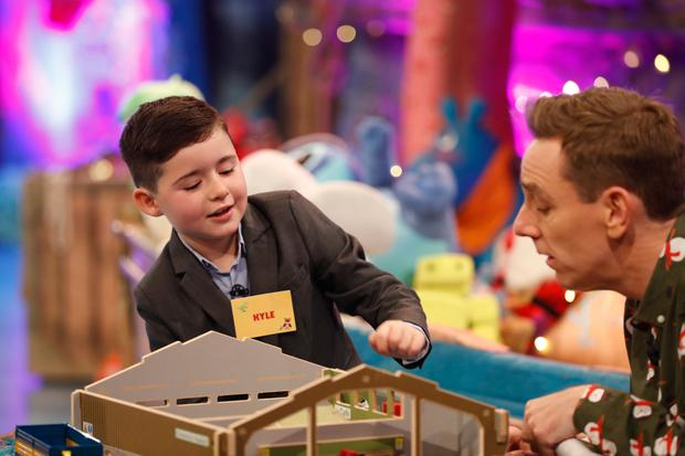 Kyle Carty, age 7, from Collinstown, Co. Westmeath pictured on the RTE One Late Late Toy Show 2017, demonstrating toys with presenter Ryan Tubridy. Picture Andres Poveda / RTE
