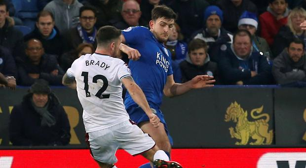 Burnley's Robbie Brady was injured in this tackle with Leicester City's Harry Maguire