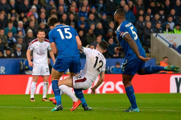 Burnley's Robbie Brady in action with Leicester City's Harry Maguire