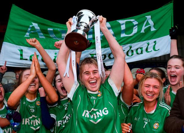 Aghada captain Emma Farmer lifts the cup as her team-mates celebrate after the All-Ireland Ladies Football Junior Club Championship Final match between Aghada and Corduff at Crettyard in Co Laois. Photo by Matt Browne/Sportsfile