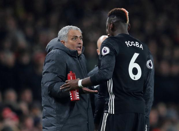 Manchester United's Paul Pogba with manager Jose Mourinho REUTERS/Eddie Keogh
