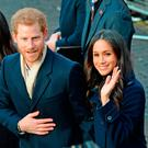 Surfing the wave: Harry and Meghan are already hugely popular as a couple and will become a favourite target of the paparazzi before they marry at Windsor Castle next May, with the American's beauty an echo of Princess Diana's Photo: Joe Giddens/PA Wire
