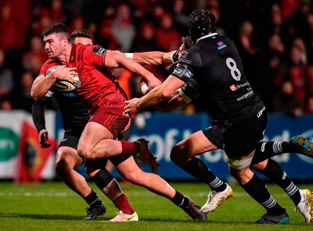 Munster's Sam Arnold gets away from Jamres Hook and James King of Ospreys on his way to scoring his side's first try. Photo: Diarmuid Greene/Sportsfile