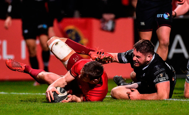 Munster's Darren Sweetnam scores his side's second try despite the efforts Gareth Thomas of Ospreys. Photo: Diarmuid Greene/Sportsfile