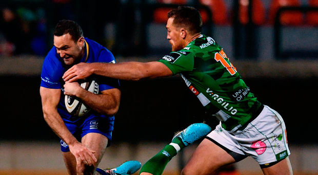 Leinster's Dave Kearney is tackled by Tommaso Allan, left, and Alberto Sgarbi of Benetton during their PRO14 match in Treviso, Italy. Photo: Ramsey Cardy/Sportsfile