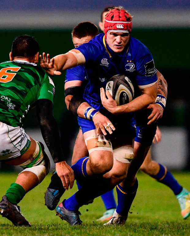 Leinster's Josh van der Flier is tackled by Whetu Douglas of Benetton. Photo: Ramsey Cardy/Sportsfile