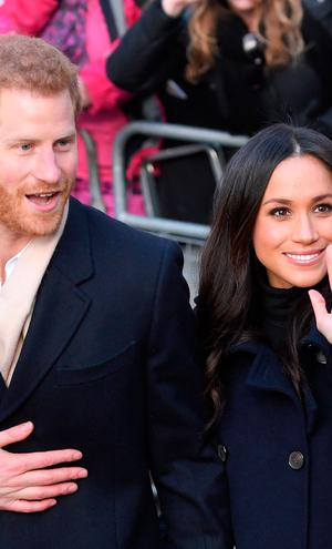 Prince Harry and fiancee Meghan Markle attend the Terrence Higgins Trust World AIDS Day charity fair at Nottingham Contemporary on December 1, 2017 in Nottingham, England