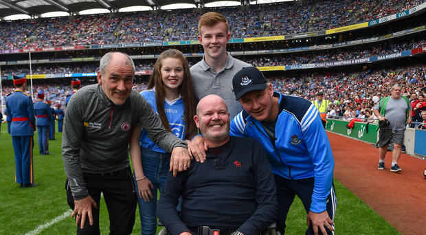 Dublin manager Jim Gavin and Tyrone manager Mickey Harte, alongside former Antrim footballer Anto Finnegan and his children Conall and Ava ahead of the GAA Football All-Ireland Senior Championship Semi-Final match between Dublin and Tyrone at Croke Park in Dublin. Photo by Ramsey Cardy/Sportsfile