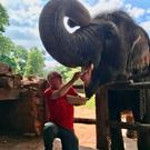 John Masterson visits an elephant orphanage in Pinnawala