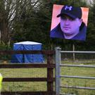 Garda preserve the scene at Waterstown Co Meath where Kane McCormack (inset) was discovered between the Meath and Kildare border Stephen Collins/Collins Photos