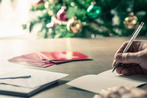 Send Christmas cards to your neighbours. Stock photo: Getty