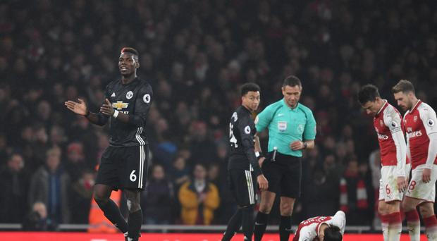 Man United's Paul Pogba after being send off for a foul on Arsenal's Hector Bellerin during the Premier League match between Arsenal and Manchester United at Emirates Stadium on December 2, 2017 in London, England. (Photo by Stuart MacFarlane/Arsenal FC via Getty Images)