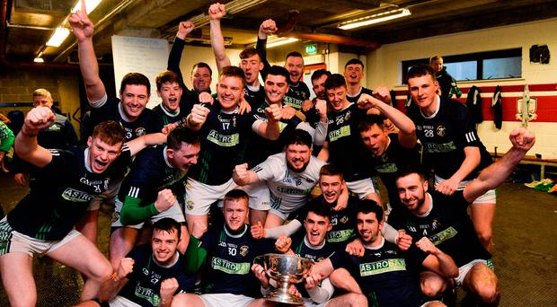Liam Mellows players celebrate with the Tom Callanan Cup after beating Gort in the Galway SHC final. Photo: Piaras Ó Mídheach/Sportsfile