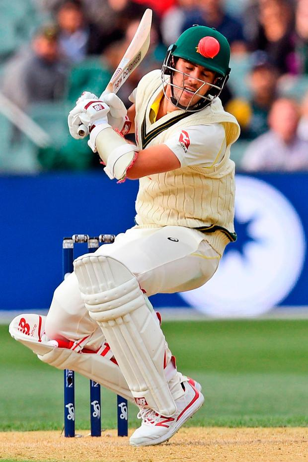 Australia's batsman Pat Cummins avoids a bouncer during the second Ashes Test match in Adelaide. Photo: Getty Images
