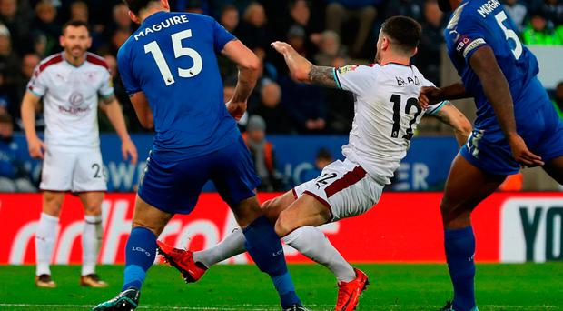 Robbie Brady is challenged by Harry Maguire of Leicester City in the incident that led to the Ireland international being carried off on a stretcher during the Premier League match at The King Power Stadium. Photo: GETTY IMAGES