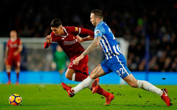 Shane Duffy battles it out with Roberto Firmino during Saturday's match at the Amex Stadium. Photo: REUTERS