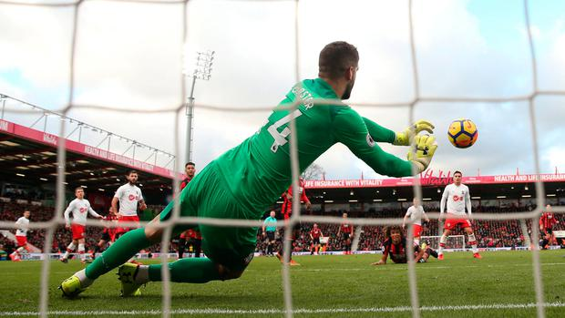 Southampton's Fraser Forster saves a diving header from Bournemouth's Nathan Ake. Photo: REUTERS