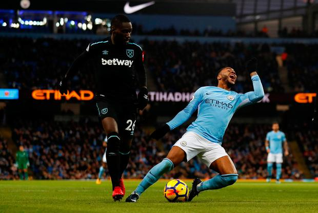 Manchester City's Raheem Sterling reacts after a tackle from West Ham United's Arthur Masuaku. Photo: REUTERS