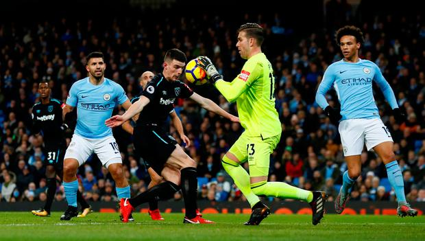 West Ham United's Adrian gathers the ball from Declan Rice. Photo: REUTERS