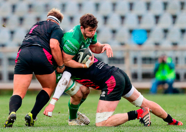 Eoghan Masterson of Connacht is tackled by George Biagi and Andrea Lovotti of Zebre. Photo by Roberto Bregani/Sportsfile