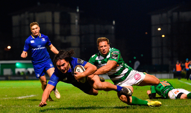James Lowe of Leinster dives over to score his side's fifth try despite the tackle of Tommaso Benvenuti of Benetton. Photo by Ramsey Cardy/Sportsfile