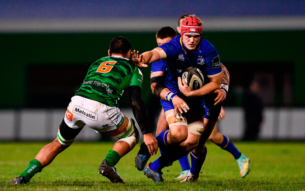 Josh van der Flier of Leinster is tackled by Whetu Douglas of Benetton. Photo by Ramsey Cardy/Sportsfile