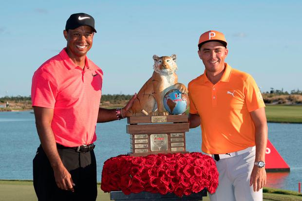 Tiger Woods with winner Rickie Fowler after the final round of the Hero World Challenge tournament at Albany. Photo credit: Kyle Terada USA TODAY Sports
