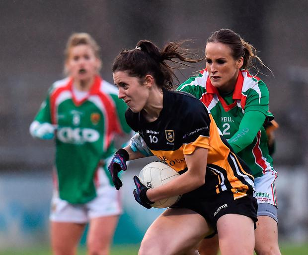 Ciara O'Sullivan of Mourneabbey in action against Sharon McGing of Carnacon. Photo by Seb Daly/Sportsfile