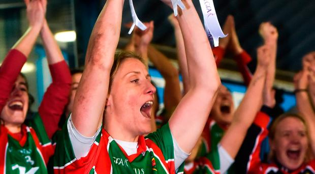 Cora Staunton lifts the trophy following Carnacon's win in the AIB All-Ireland Ladies Club SFC final at Parnell Park. Photo by Seb Daly/Sportsfile