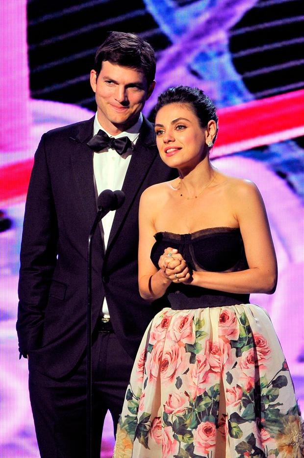 Ashton Kutcher (L) and Mila Kunis speak onstage during the 2018 Breakthrough Prize at NASA Ames Research Center on December 3, 2017 in Mountain View, California. (Photo by Steve Jennings/Getty Images for Breakthrough Prize )