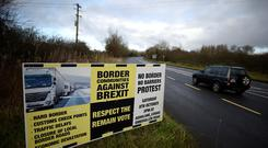 A sign from Border Communities Against Brexit is seen on the borderline between County Cavan in Ireland and County Fermanagh in Northern Ireland near Woodford, Ireland, November 30, 2017. REUTERS/Clodagh Kilcoyne