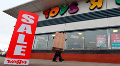 Sale signs outside a Toys R Us store in Basingstoke, Hampshire Credit: Andrew Matthews/PA Wire