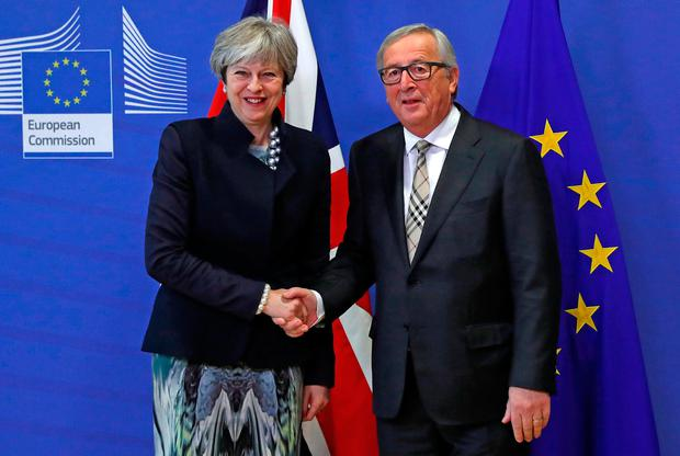 Britain's Prime Minister Theresa May is welcomed by European Commission President Jean-Claude Juncker at the EC headquarters in Brussels, Belgium December 4, 2017. REUTERS/Yves Herman