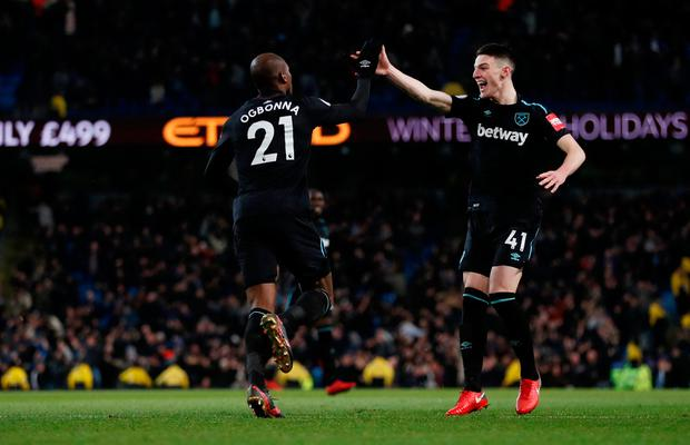 Soccer Football - Premier League - Manchester City vs West Ham United - Etihad Stadium, Manchester, Britain - December 3, 2017 West Ham United's Angelo Ogbonna celebrates scoring their first goal with Declan Rice. REUTERS/Russell Cheyne