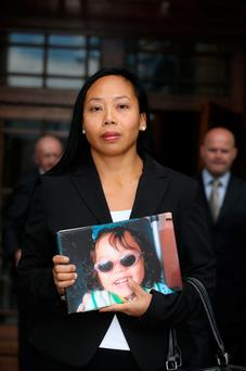 Angela Neiland, with an address in Cabinteely, Dublin pictured holding an image of her son, Tristan Pic: Collins Courts