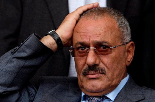 FILE - In this April 8, 2011 file photo, then Yemeni President Ali Abdullah Saleh attends a rally with his supporters, in Sanaa, Yemen. Saleh, Yemen's former president and longtime strongman, was killed Monday, Dec. 4, 2017, according to multiple Yemeni officials, as his loyalists and Shiite rebels battled for control of the capital. (AP Photo/Muhammed Muheisen, File)