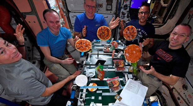 Astronauts posted pictures over the weekend of their small, made-from-scratch pizzas
