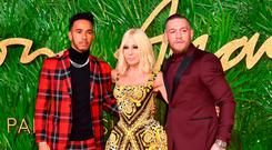 Lewis Hamilton, Donatella Versace and Conor McGregor attending the Fashion Awards 2017, in partnership with Swarovski, held at the Royal Albert Hall, London. Picture Date: Monday 4th December, 2017. Photo credit should read: Matt Crossick/PA Wire