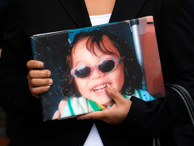 Angela Neiland holding a photo of her beloved boy. Photo: Collins