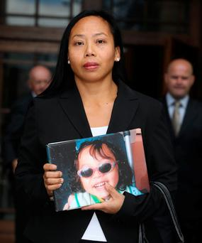 Angela Neiland, holding a picture of her son Tristan. Photo: Collins Courts