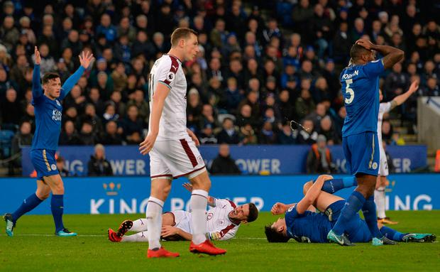 Robbie Brady (left) goes down clutching his knee after clashing with Leicester City's Harry Maguire at the King Power Stadium on Saturday. Photo: Reuters