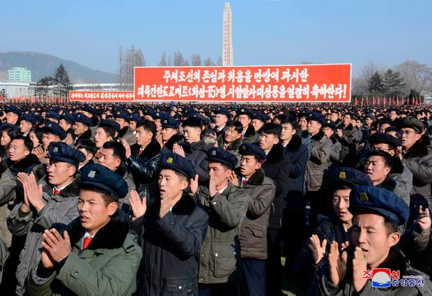 North Koreans applaud the country's nuclear progress in this photo released by the Korean Central News Agency (KCNA) yesterday. Photo: Reuters